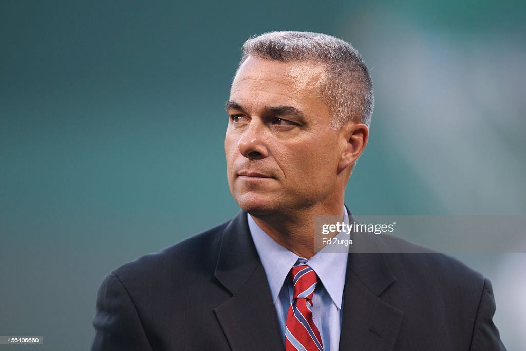 Kansas City Royals general manager Dayton Moore looks on prior to a game between the Detroit Tigers and Kansas City Royals at Kauffman Stadium on September 19, 2014 in Kansas City, Missouri.