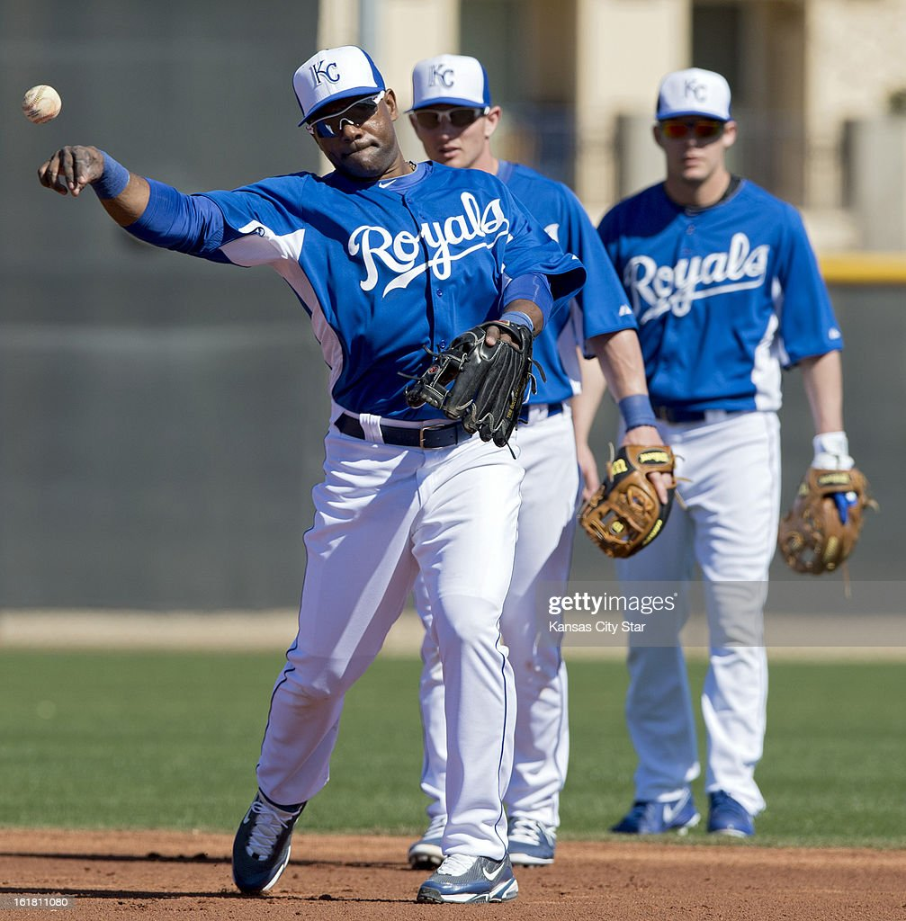 Kansas City Royals infielder Miguel Tejada taks part in fielding drills as teammates Johnny Giavotella and Chris Getz look on during spring training on Saturday, February 16, 2013, in Surprise, Arizona.