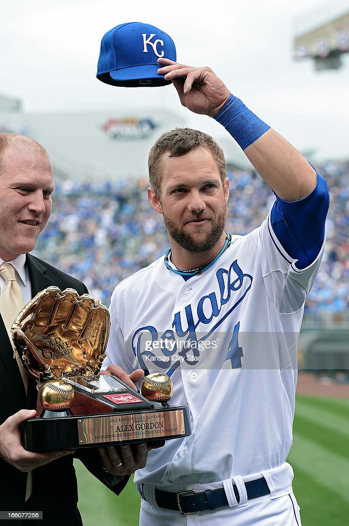 Kansas City Royals left fielder Alex Gordon (4) acknowledges the cheers after receiving his Gold Glove award before Monday's baseball game against the Minnesota Twins on April 8, 2013, at Kauffman Stadium in Kansas City, Missouri.