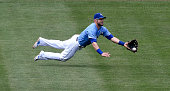 Kansas City Royals left fielder Alex Gordon makes a diving catch for an out on Minnesota Twins' Trevor Plouffe during the fourth inning on Sunday...