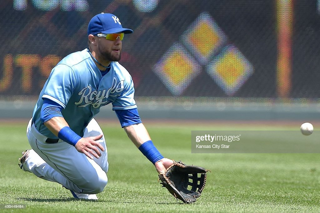 Kansas City Royals left fielder Alex Gordon (4) robs Cleveland Indians' Michael Bourn of a hit in the third inning during Wednesday's baseball game on June 11, 2014 at Kauffman Stadium in Kansas City, Mo.