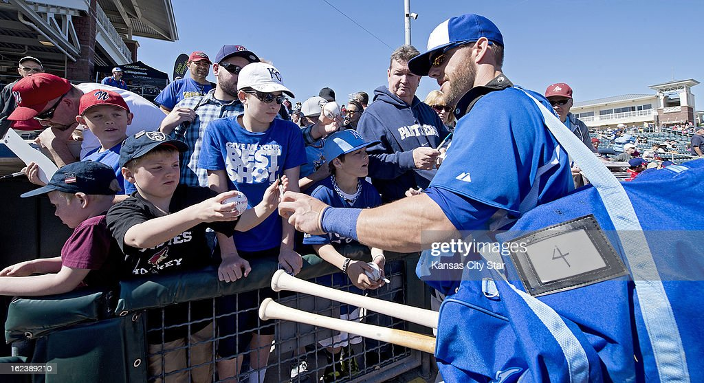 Kansas City Royals left fielder Alex Gordon (4) stops to sign autographs before the start of a spring training baseball game against the Texas Rangers in Surprise, Arizona, Friday, February 22, 2013. The game ended in a 5-5 tie.