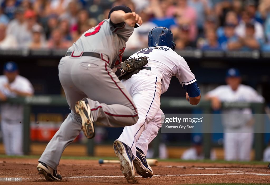Kansas City Royals left fielder Alex Gordon was tagged out by Atlanta Braves third baseman Chris Johnson on a rundown between third base and home...