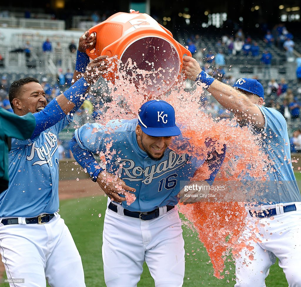 Kansas City Royals left fielder Paulo Orlando gets the Gatorade shower from Salvador Perez and Erik Kratz following the team's 41 win over the...