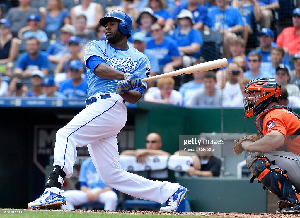 Kansas City Royals' Lorenzo Cain follows through on a single during the first inning on Sunday, June 26, 2016, at Kauffman Stadium in Kansas City, Mo.