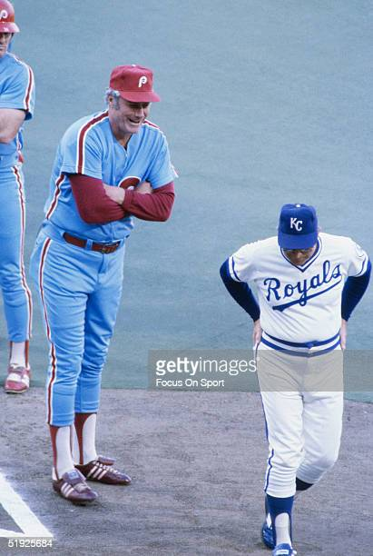 Kansas City Royals manager Jim Frey talks with rival manager of the Philadelphia Phillies Dallas Green during the World Series at Royals Stadium in...