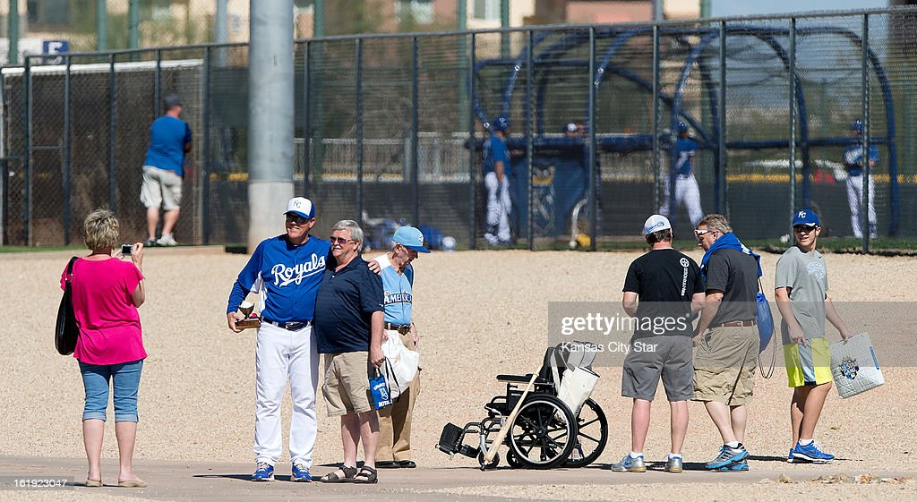 Kansas City Royals manager Ned Yost (3) stops to pose for a fans photograph at the end of a spring training workout in Surprise, Arizona, Sunday, February 17, 2013.