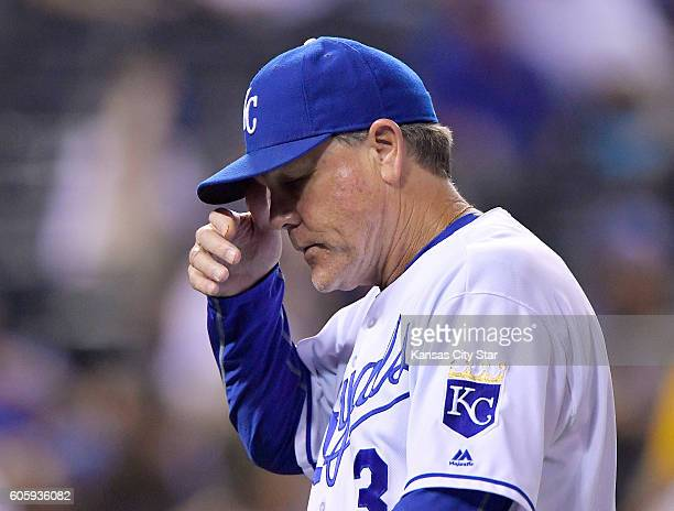 Kansas City Royals manager Ned Yost walks back to the dugout after relieving pitcher Brooks Pounders in the eighth inning against the Oakland...