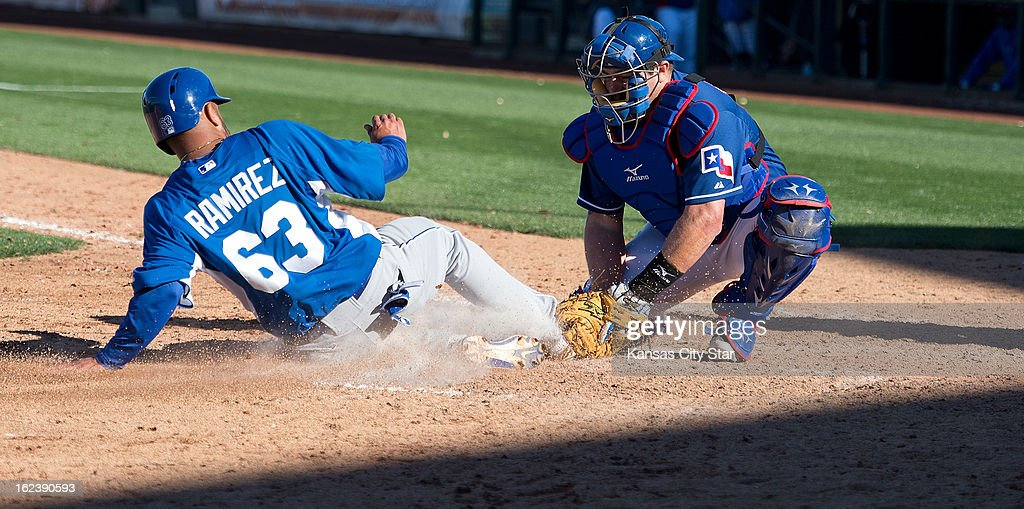 Kansas City Royals' Max Ramirez (63) is tagged out at the plate by Texas Rangers catcher Konrad Schmidt (68) in the ninth inning of a spring training game in Surprise, Arizona, Friday, February 22, 2013. The game ended in a 5-5 tie.