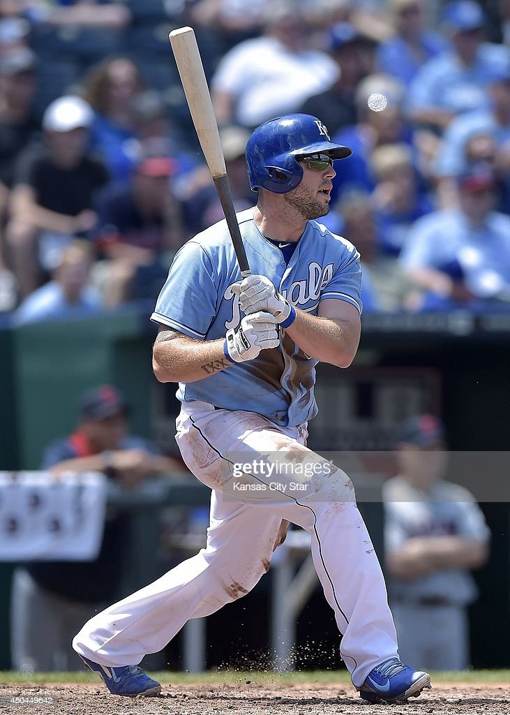 Kansas City Royals' Mike Moustakas (8) heads to first on a single in the fourth inning during Wednesday's baseball game against the Cleveland Indians on June 11, 2014 at Kauffman Stadium in Kansas City, Mo.