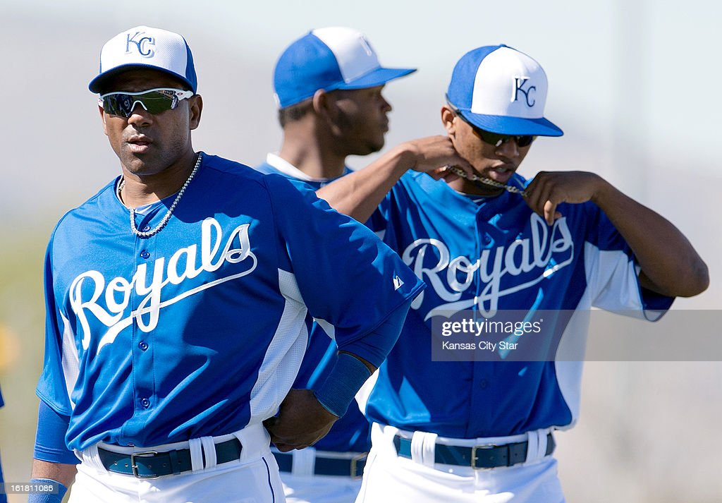 Kansas City Royals' Miquel Tejada, left, and Alcides Escobar take the field during spring training on Saturday, February 16, 2013, in Surprise, Arizona.