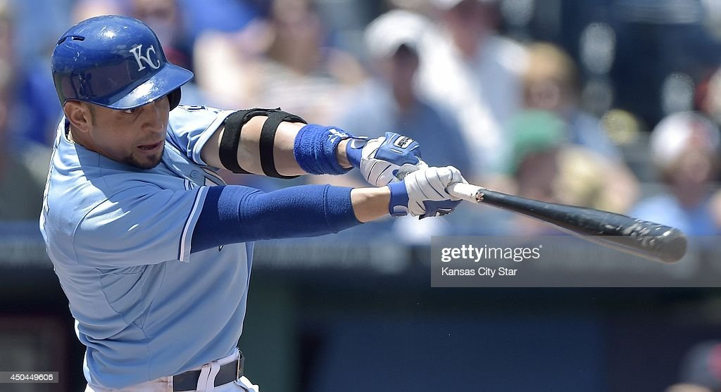 Kansas City Royals' Omar Infante (14) follows through on a sacrifice fly to score Kansas City Royals in the third inning during Wednesday's baseball game against the Cleveland Indians on June 11, 2014 at Kauffman Stadium in Kansas City, Mo.