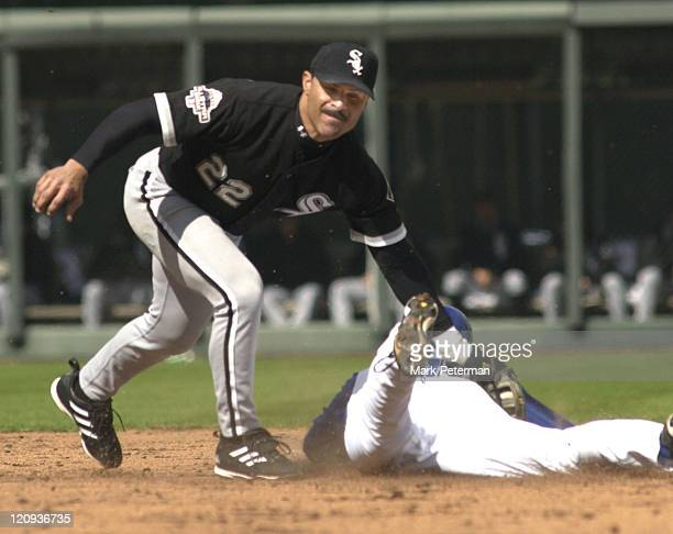Kansas City Royals outfielder David DeJesus slides underneath the tag of Chicago White Sox shortstop Jose Valentin in the sixth inning of a game at...