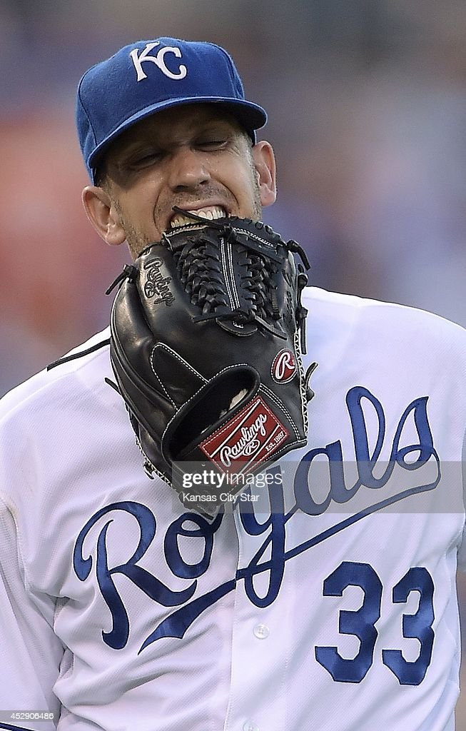 Kansas City Royals pitcher James Shields bites his glove to quell the pain after being hit by the ball in the third inning against the Minnesota Twins on Tuesday, July 29, 2014, at Kauffman Stadium in Kansas City, Mo.
