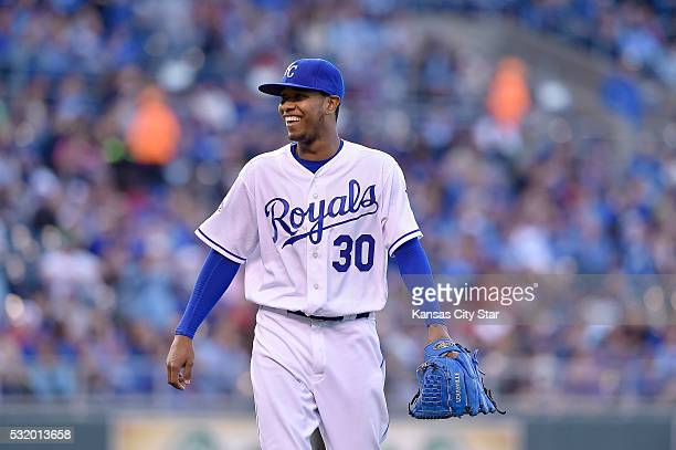 Kansas City Royals pitcher Yordano Ventura smiles after forcing the Boston Red Sox's Dustin Pedroia to ground into a double play to end the third...