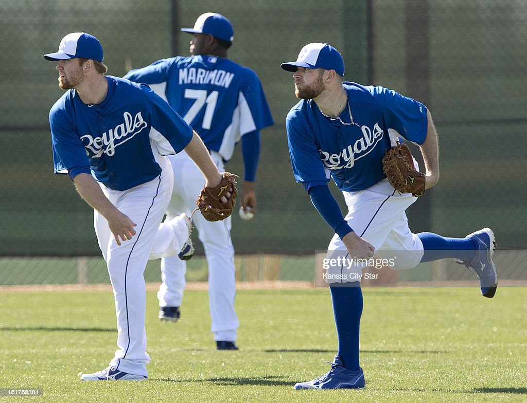 Kansas City Royals pitchers Wade Davis, right, and Blaine Boyer, left, warm up during spring training on Friday, February 15, 2013, in Surprise, Arizona.