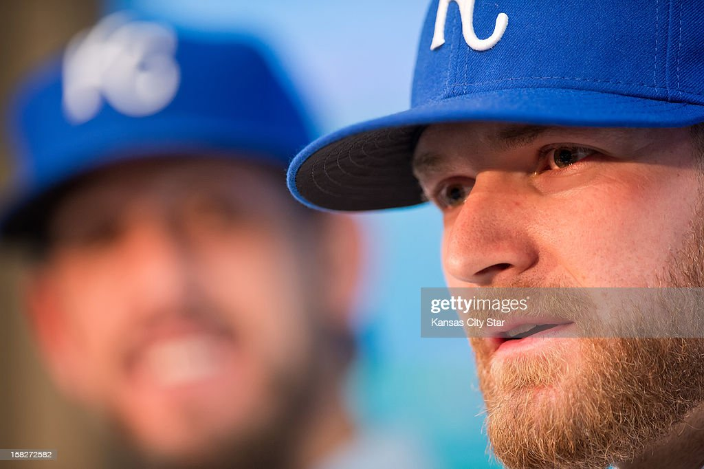 Kansas City Royals pitchers Wade Davis, right, and James Shields, looking on at left, obtained in a trade with the Tampa Bay Rays, speak during their introductory news conference, Wednesday, December 12, 2012, at Kauffman Stadium in Kansas City, Missouri.