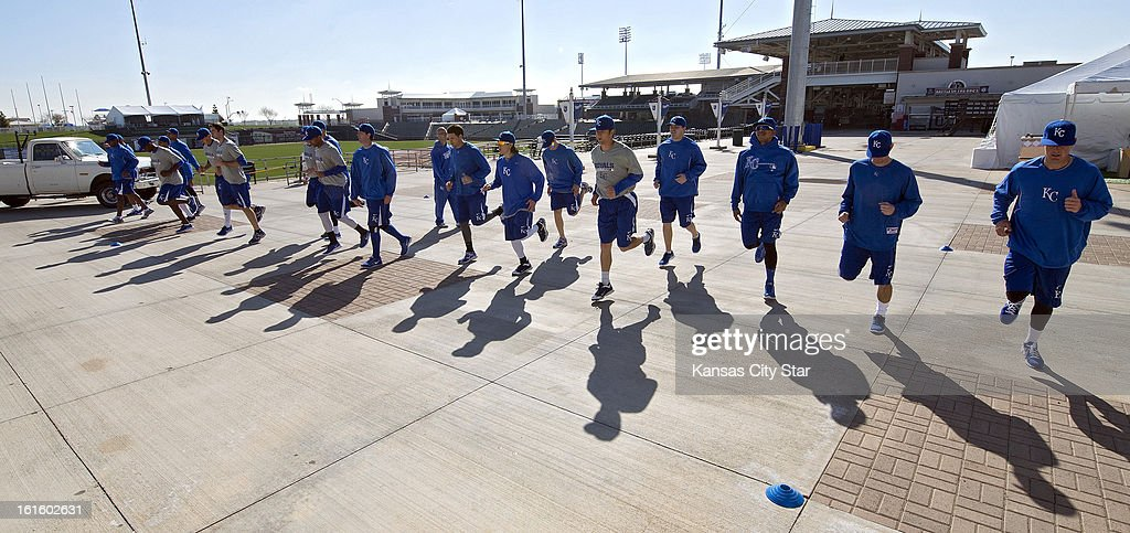 Kansas City Royals pitchers warmup on the concourse at Surprise Stadium before hitting the practice fields for a spring training workout in Suprise, Arizona, Tuesday, February 12, 2013.