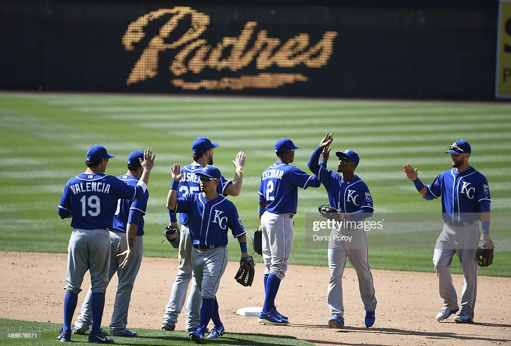 Kansas City Royals players high-five after getting the final out during the ninth inning of a baseball game against the San Diego Padres at Petco Park May 7, 2014 in San Diego, California. The Royals won 8-0.