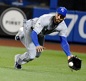 Kansas City Royals right fielder Alex Rios dives to make to catch a fly ball hit by the New York Mets' Daniel Murphy in the first inning during Game...