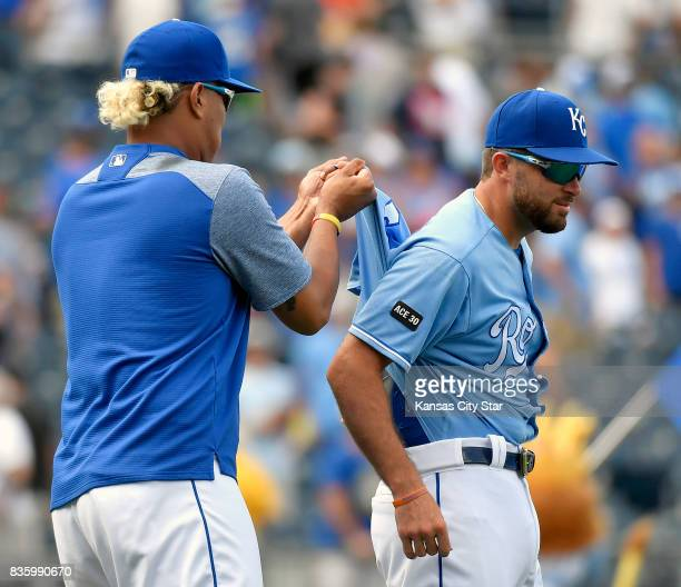 Kansas City Royals' Salvador Perez pulls the shirt out of the pants of Drew Butera after the team's 74 win over the Cleveland Indians on Sunday Aug...