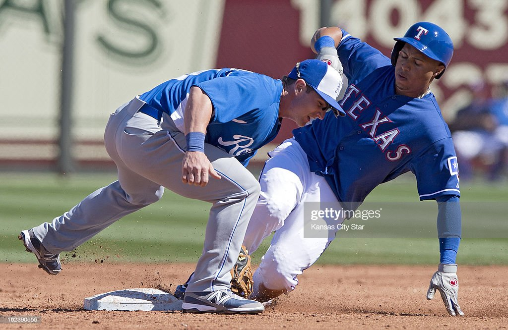 Kansas City Royals second baseman Johnny Giavotella (9) tags out Texas Rangers center fielder Leonys Martin (2) to end the third inning of a spring training game in Surprise, Arizona, Friday, February 22, 2013. The game ended in a 5-5 tie.