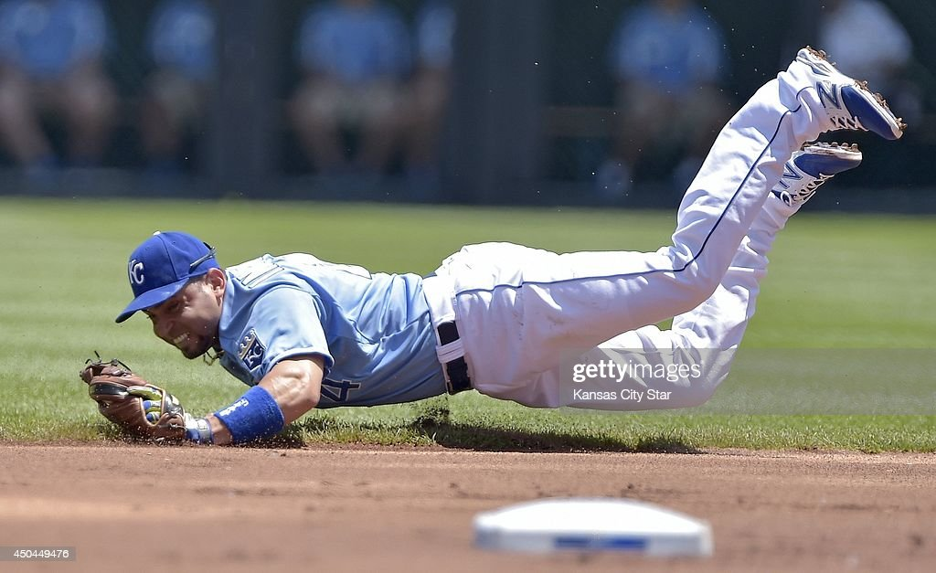 Kansas City Royals second baseman Omar Infante (14) stopped a grounder by Cleveland Indians' Jason Kipnis in the first inning, but couldn't make a play as Kipnis reached first during Wednesday's baseball game on June 11, 2014 at Kauffman Stadium in Kansas City, Mo.