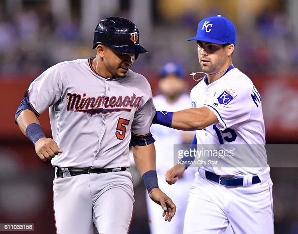 Kansas City Royals second baseman Whit Merrifield right tags out the Minnesota Twins' Eduardo Escobar on an attempted steal and rundown in the fifth...