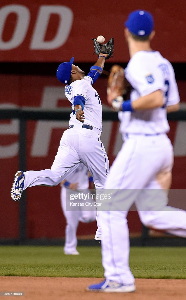 Kansas City Royals shortstop Alcides Escobar left snags an out on the Seattle Mariners' James Jones in the ninth inning on Wednesday Sept 23 at...