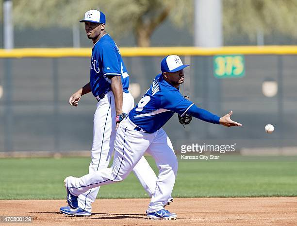 Kansas City Royals shortstop Alcides Escobar watches Christian Colon take his turn at an infield drill during spring training in Surprise Ariz on...