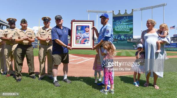 Kansas City Royals starting pitcher Ian Kennedy is honored with his family as the team's nominee for the Bob Feller Act of Valor Award before a game...