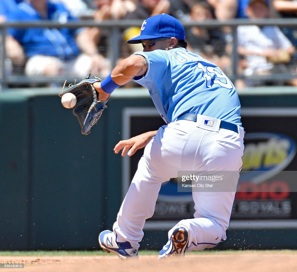 Kansas City Royals third baseman Cheslor Cuthbert makes the stop on a grounder by Chicago White Sox's Austin Jackson before starting the double play during the third inning on Sunday, May 29, 2016, at Kauffman Stadium in Kansas City, Mo.