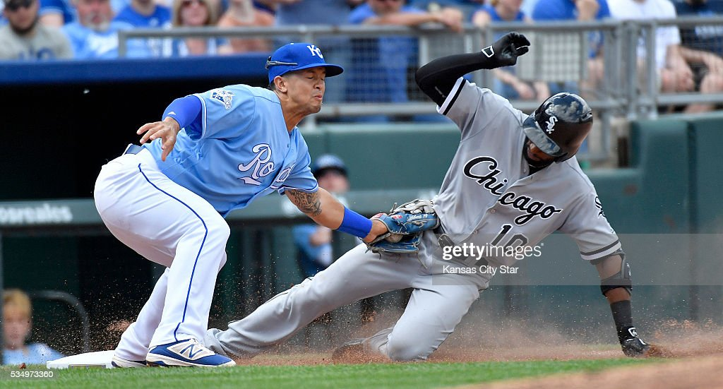 Kansas City Royals third baseman Cheslor Cuthbert tags out the Chicago White Sox's Austin Jackson trying to stretch a hit into a triple on the throw from center fielder Lorenzo Cain in the seventh inning on Saturday, May 28, 2016, at Kauffman Stadium in Kansas City, Mo.