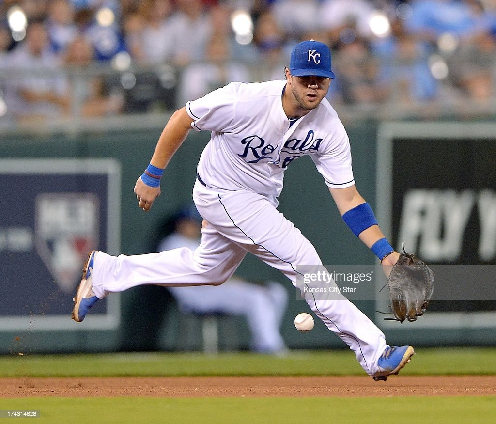 Kansas City Royals third baseman Mike Moustakas runs down a grounder by the Baltimore Orioles' Adam Jones before throwing him out at first in the seventh inning at Kauffman Stadium in Kansas City, Missouri, on Tuesday, July 23, 2013.