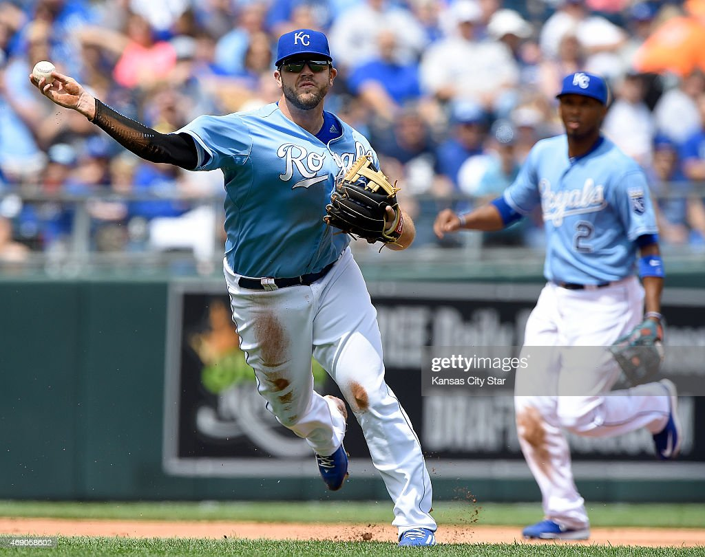 Kansas City Royals third baseman Mike Moustakas (8) throws out Chicago White Sox's Alexei Ramirez on a grounder to end the top of the second inning on Thursday, April 9, 2015, at Kauffman Stadium in Kansas City, Mo.