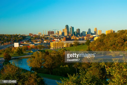 'Kansas City skyline, trees, and a lake'
