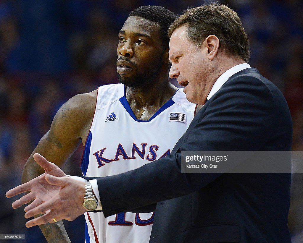 Kansas coach Bill Self speaks with Elijah Johnson late in an 85-80 upset loss at the hands of Oklahoma State at Allen Fieldhouse in Lawrence, Kansas, on Saturday, February 2, 2013.