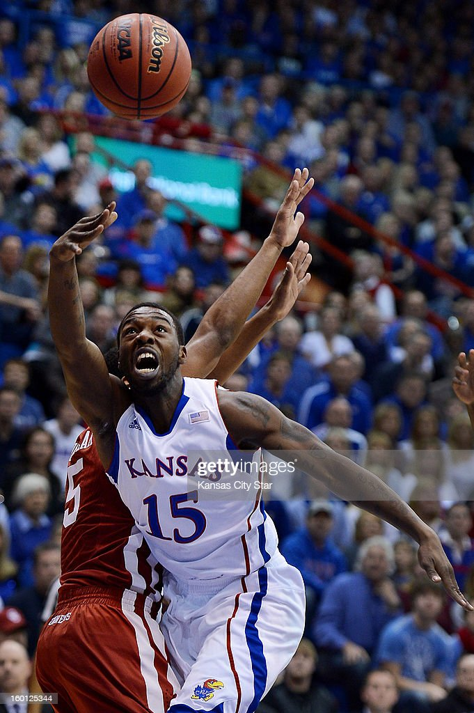 Kansas' Elijah Johnosn (15) shoots against Oklahoma's Je'lon Hornbeak during the first half at Allen Fieldhouse in Lawrence, Kansas, on Saturday, January 26, 2013. Kansas won, 67-54.