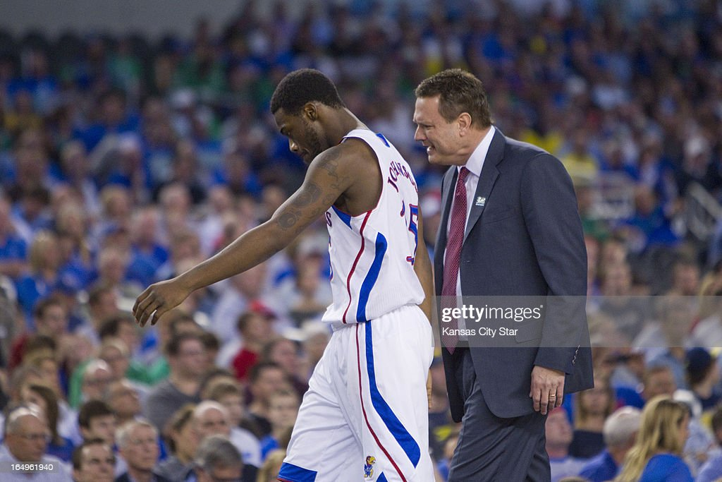 Kansas' Elijah Johnson (15) walks to the bench after picking up a foul as head coach Bill Self talks with him in the first half against Michigan in the NCAA Tournament's Sweet 16 at Cowboys Stadium in Arlington, Texas on Friday, March 29, 2013.