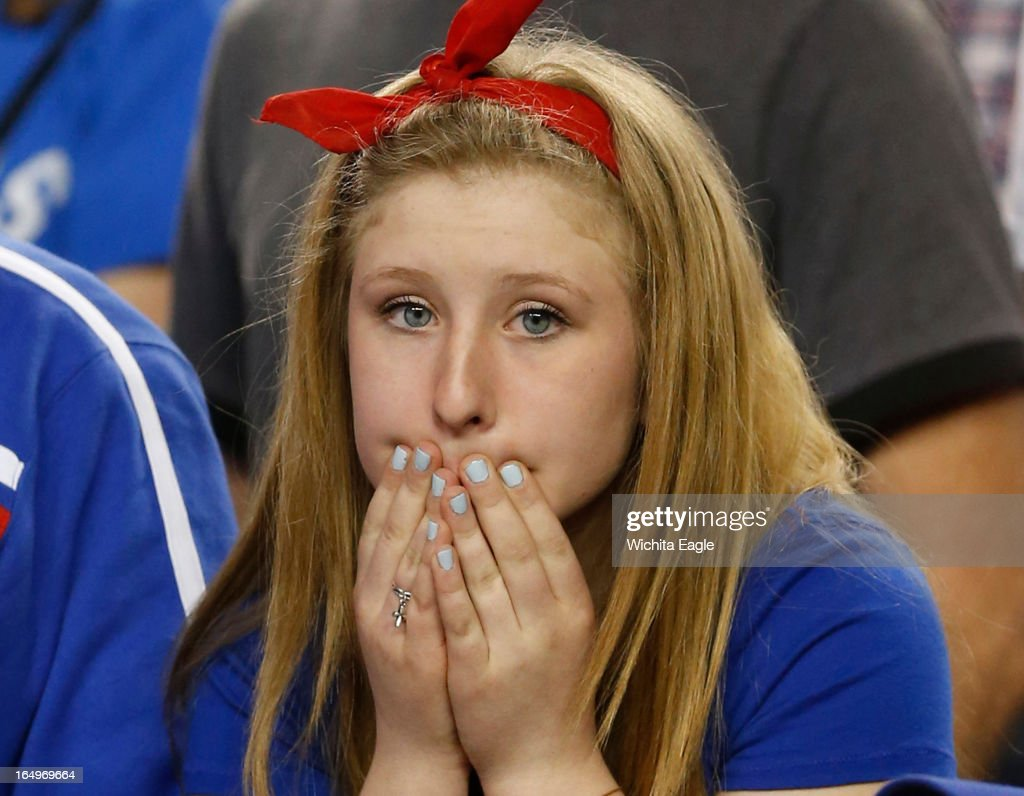 A Kansas fan reacts in the final seconds of an 87-85 loss in overtime against Michigan in the NCAA Tournament's Sweet 16 at Cowboys Stadium in Arlington, Texas on Friday, March 29, 2013.