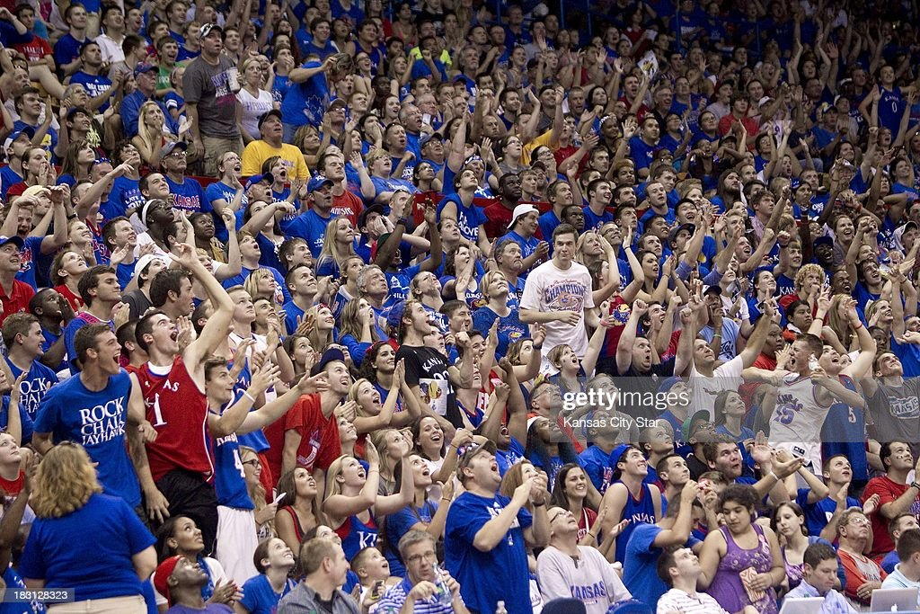 Kansas fans cheer as they watched a video during the University of Kansas Late Night at Phog Allen Fieldhouse in Lawrence, Kansas, Friday, October 4, 2013.