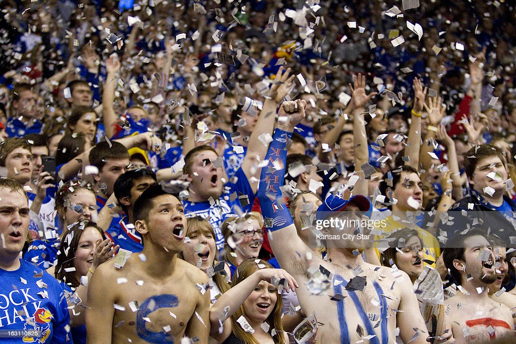 Kansas fans tossed torn up newspaper prior to the start of the game against Texas Tech at Allen Fieldhouse in Lawrence, Kansas, Monday, March 4, 2013. Kansas defeated Texas Tech, 79-42.