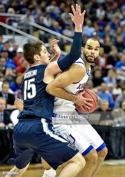 Kansas forward Perry Ellis works against the defense of Villanova guard Ryan Arcidiacono during the first half in the finals of the NCAA Tournament's...