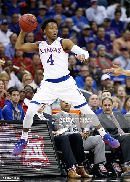 Kansas guard Devonte Graham grabs a loose ball before going out of bounds during the quarterfinal round of the Big 12 Men's Basketball Championship...