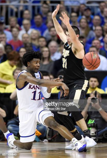 Kansas guard Josh Jackson throws a pass around Purdue guard Dakota Mathias in the first half during the Sweet Sixteen round of the NCAA Tournament at...