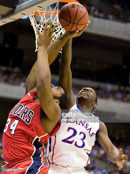 Kansas guard Mario Little blocks a shot by Richmond forward Derrick Williams during the first half in a Southwest Regional semifinal game of the 2011...