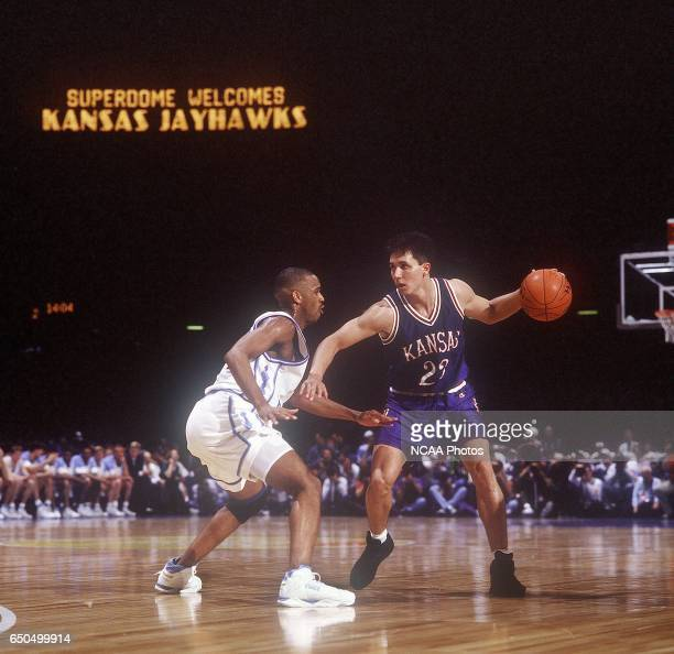 Kansas guard Rex Walters works his way down court against North Carolina's Derrick Phelps during the NCAA National Semifinals held in New Orleans...