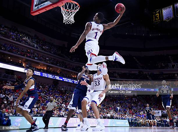 Kansas guard Wayne Selden converts an alleyoop pass from teammate Devonte' Graham in the second half against Connecticut in the second round of the...