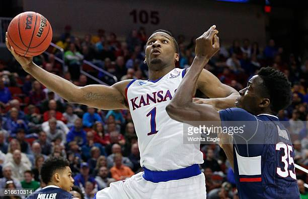 Kansas guard Wayne Selden Jr makes a shot in the second half against Connecticut's Amida Brimah in the second round of the NCAA Tournament at Wells...
