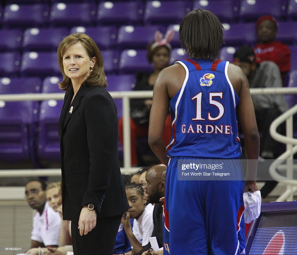 Kansas head coach Bonnie Hendrickson encourages her team as they rally for a 76-75 win against Texas Christian at Daniel-Meyer Coliseum in Fort Worth, Texas, on Wednesday, February 13 2013.